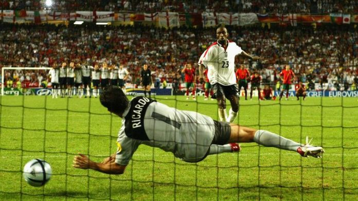 Portugal goalkeeper Ricardo took his gloves off before saving Vassell's attempt - and then scored the winning penalty himself