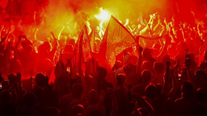 Liverpool fans celebrated outside Anfield after they were crowned Premier League champions