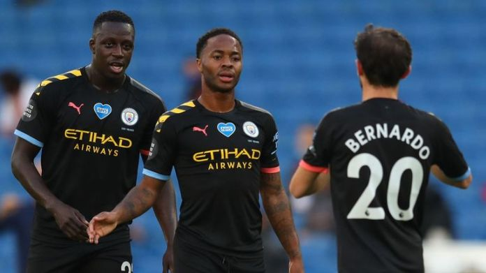Raheem Sterling celebrates after opening the scoring for Manchester City in Brighton