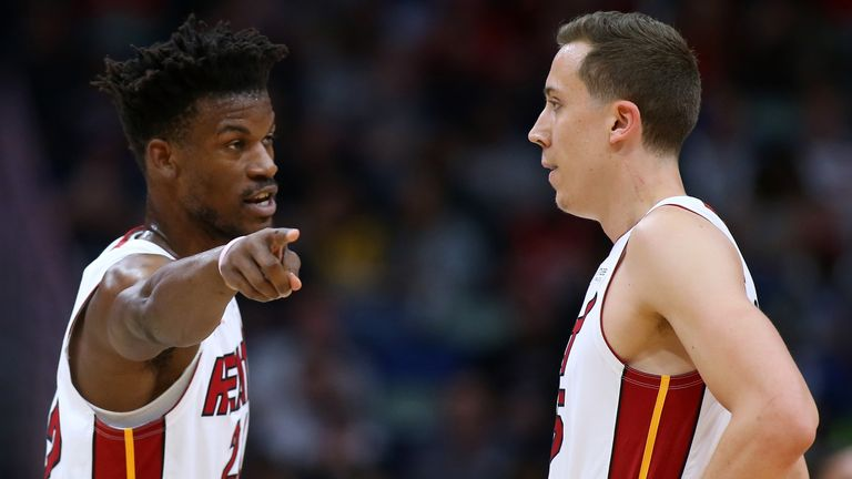 Jimmy Butler advises Duncan Robinson during the Miami Heat's playoff series against the  Milwaukee Bucks