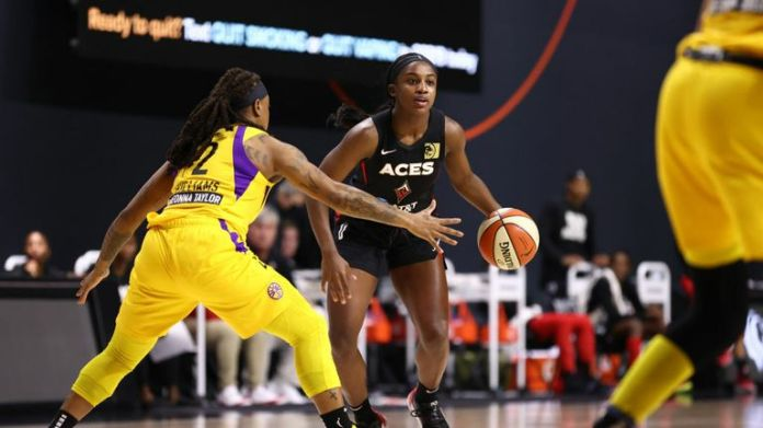 Jackie Young #0 of the Las Vegas Aces handles the ball against the Los Angeles Sparks on September 12, 2020 at Feld Entertainment Center in Palmetto, Florida.