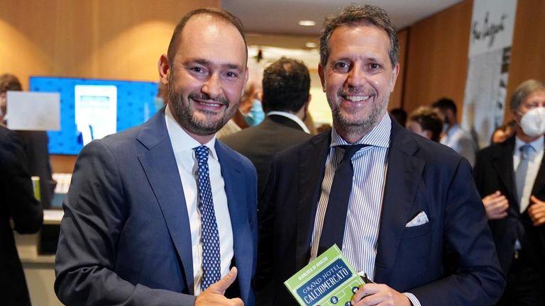 Gianluca Di Marzio poses with Juventus' chief football officer Fabio Paratici at the presentation of his book Grand Hotel Calciomercato