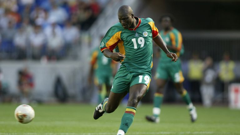 Papa Bouba Diop of Senegal charges forward during the FIFA World Cup Finals 2002 Group A match between Uruguay and Senegal played at the Suwon World Cup Stadium, in Suwon, South Korea on June 11, 2002. The match ended in a 3-3 draw