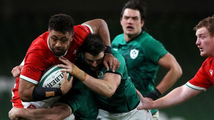 Faletau is tackled by Robbie Henshaw