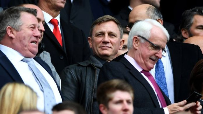James Bond actor Daniel Craig watches on at Anfield