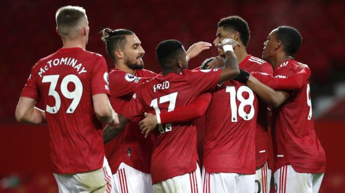 Bruno Fernandes is mobbed by team-mates after scoring Man Utd's sixth