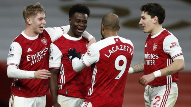 Arsenal's Bukayo Saka (second left) celebrates scoring his side's third goal of the game