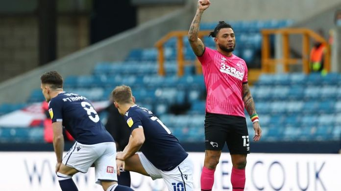 Millwall's players knelt at the start of their Derby game
