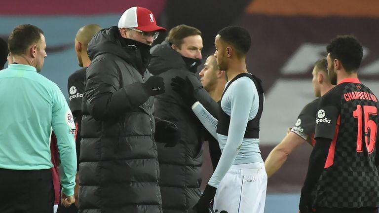 Jurgen Klopp congratulates the Aston Villa players at the final whistle