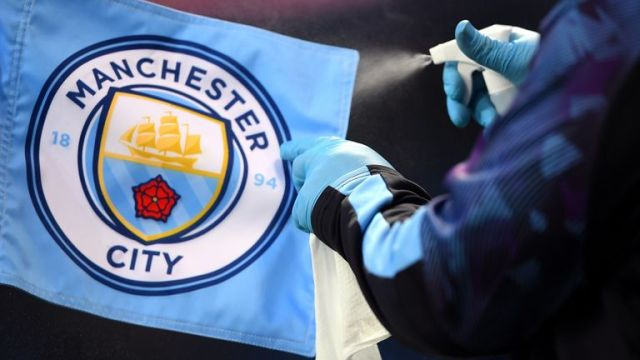 Manchester City v Liverpool - Premier League - Etihad Stadium A corner flag is disinfected during the Premier League match at the Etihad Stadium, Manchester.