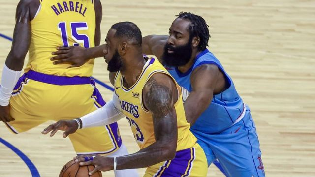 Los Angeles Lakers forward LeBron James (23) drives against Houston Rockets guard James Harden (13) during the second quarter of an NBA basketball game Tuesday, Jan. 21, 2021, in Houston. (Troy Taormina/Pool Photo via AP)