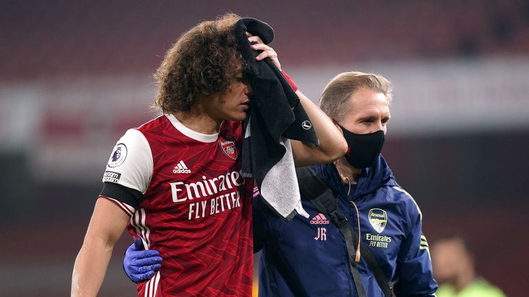 Arsenal's David Luiz receives treatment after a clash of heads with Wolverhampton Wanderers' Raul Jimenez (not pictured) during the Premier League match at the Emirates Stadium
