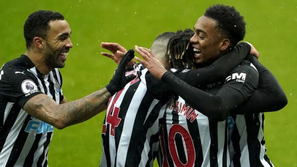 Joe Willock celebrates scoring on his Newcastle debut