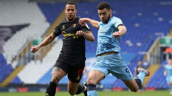Watford's William Troost-Ekong (left) and Coventry City's Maxime Biamou battle for the ball