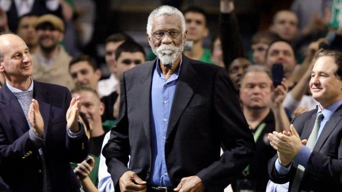Former Boston Celtic Bill Russell receives a standing ovation after being introduced prior to the Celtics' NBA basketball game against the Detroit Pistons