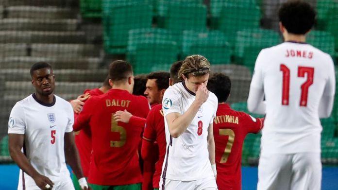 England players react after Portugal U21 score