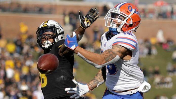 Bledsoe successfully defends a pass intended for Florida wide receiver Freddie Swain. (AP Photo/Jeff Roberson)