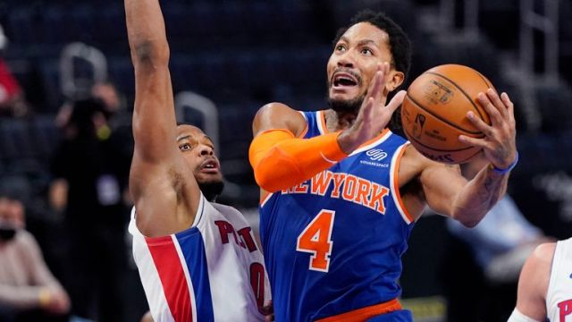 New York Knicks guard Derrick Rose (4) attempts a layup as Detroit Pistons guard Dennis Smith Jr. (0) defends during the first half of an NBA basketball game, Sunday, Feb. 28, 2021, in Detroit.