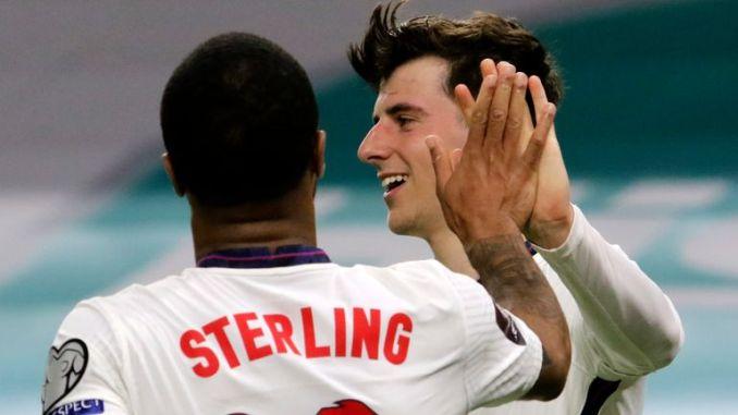 Mason Mount celebrates with Raheem Sterling