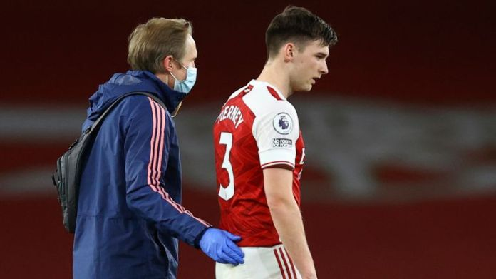 Kieran Tierney leaves the pitch after picking up an injury (AP)