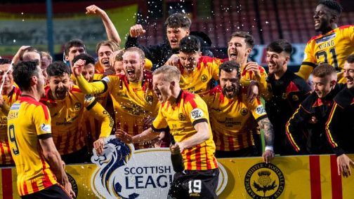 Partick Thistle players celebrate winning the Scottish League One title at Firhill.