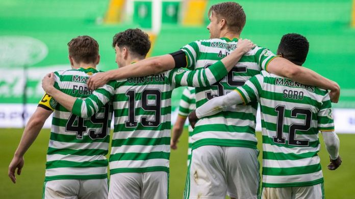 GLASGOW, SCOTLAND - MAY 12: Celtic's Kristoffer Ajer celebrates his goal with teammates during the Scottish Premiership match between Celtic and St Johnstone at Celtic Park on May 12, 2021, in Glasgow, Scotland. (Photo by Craig Williamson / SNS Group)