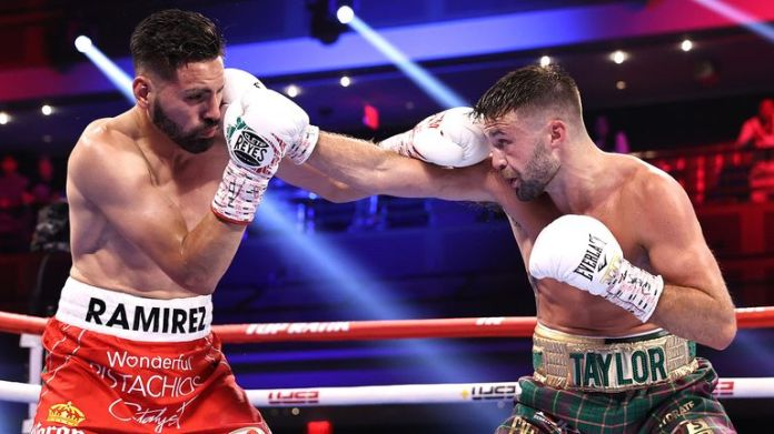 LAS VEGAS, NEVADA - MAY 22: Jose Ramirez(L) and Josh Taylor(R) exchange punches during their fight for the Undisputed junior welterweight championship at Virgin Hotels Las Vegas on May 22, 2021 in Las Vegas, Nevada. (Photo by Mikey Williams/Top Rank Inc via Getty Images).
