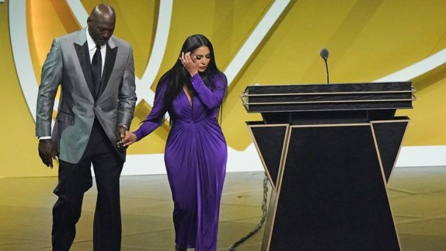 Michael Jordan escorts Vanessa Bryant off the stage after Bryant's late husband, Kobe Bryant, was enshrined as part of the 2020 Basketball Hall of Fame class