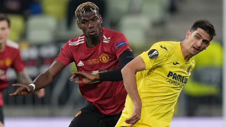 Manchester United midfielder Paul Pogba battles for possession with Gerard Moreno of Villarreal CF
