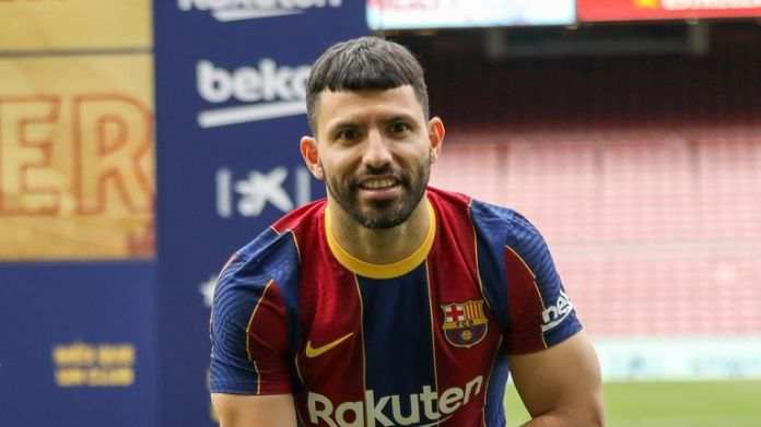 Argentinian forward Sergio 'Kun' Aguero poses for the media during his official presentation after signing for FC Barcelona in Barcelona, Spain, Monday May. 31, 2021