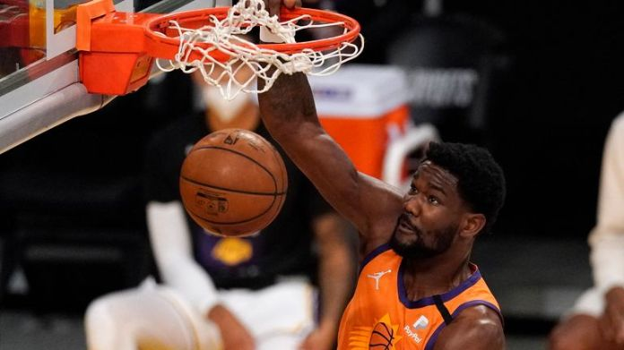 Phoenix Suns center Deandre Ayton dunks during the first half in Game 4 of an NBA basketball first-round playoff series against the Los Angeles Lakers Sunday, May 30, 2021, in Los Angeles.