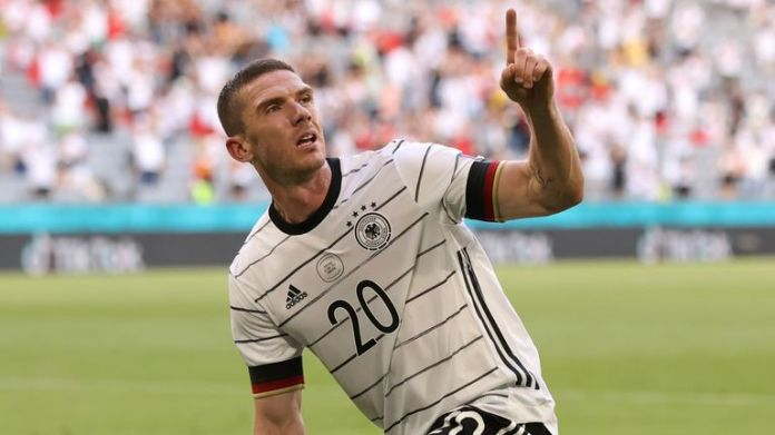 Robin Gosens celebrates after scoring Germany's fourth goal against Portugal
