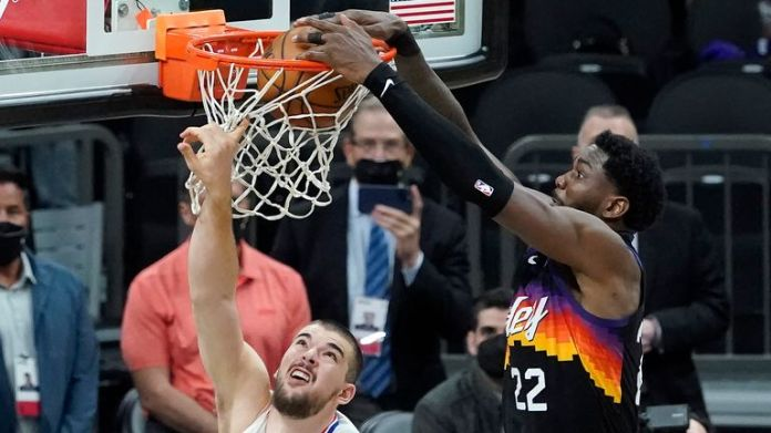 Phoenix Suns center Deandre Ayton, right, scores over Los Angeles Clippers center Ivica Zubac during the second half of Game 2 of the NBA basketball Western Conference Finals, Tuesday, June 22, 2021, in Phoenix.