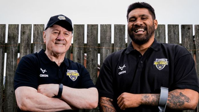Combined Nations head coach Tim Sheens with Mose Masoe, whose foundation will benefit from the sale of replica All-Stars shirts