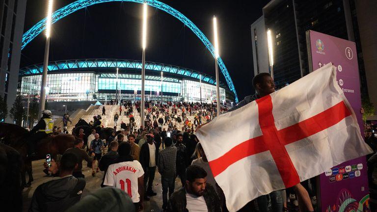 PA - England fans celebrate outside Wembley