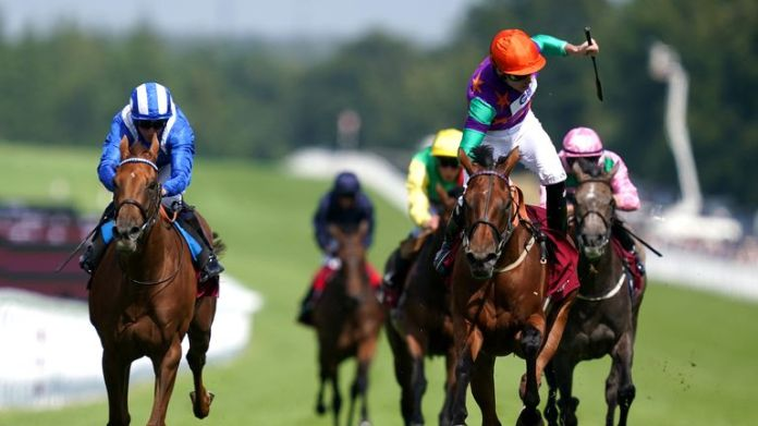Kieran Shoemark stands up in the saddle as Lady Bowthorpe wins the Nassau Stakes