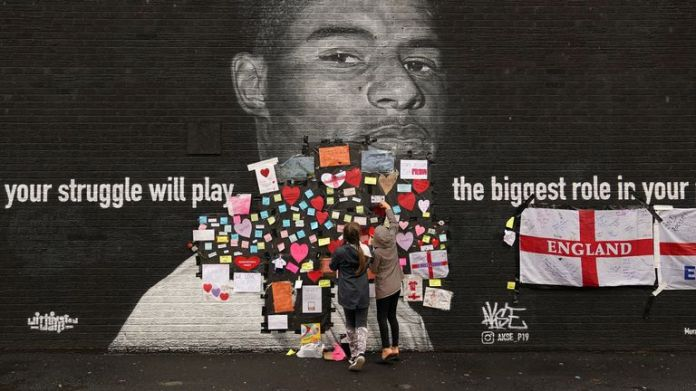 Supportive messages have been placed on Marcus Rashford's mural after it was defaced in the wake of the loss to Italy