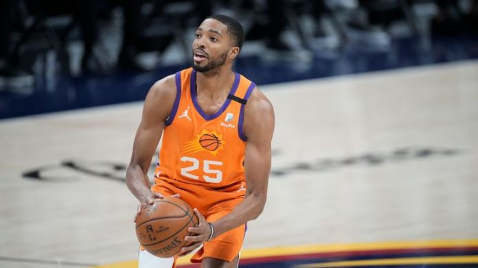 Phoenix Suns forward Mikal Bridges (25) in the first half of Game 3 of an NBA second-round playoff series Friday, June 11, 2021, in Denver. (AP Photo/David Zalubowski)...................