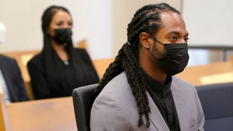 Richard Sherman, right, sits in court as his wife Ashley Sherman, left, looks on during a hearing