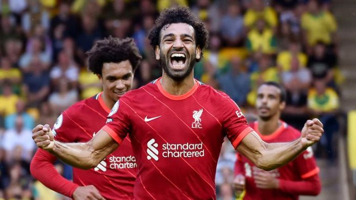 Liverpool's Mohamed Salah celebrates after scoring his side's third goal