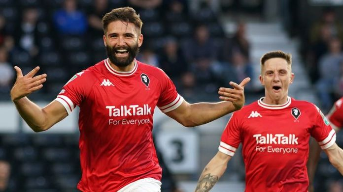 Salford City's Jordan Turnbull (left) celebrates scoring against Derby in Carabao Cup first round