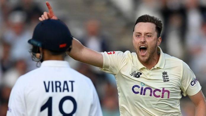 Robinson celebrates taking Kohli's wicket
