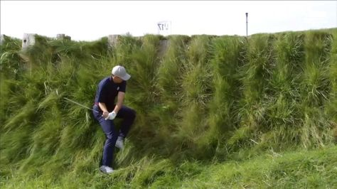 Jordan Spieth produced an incredible recovery from thick grass on a hill, hitting his shot unsighted to inside 10 feet at the par-three 17th!