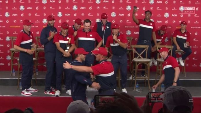 Bryson DeChambeau and Brooks Koepka put their rivalry aside to embrace with the Ryder Cup trophy after Team USA's record victory at Whistling Straits.