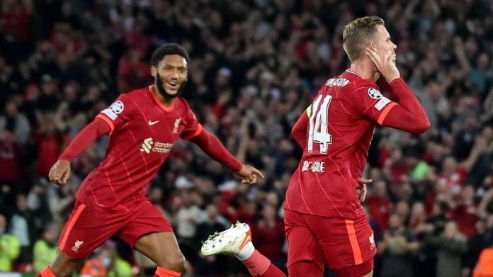Liverpool's Jordan Henderson celebrates after scoring against AC Milan