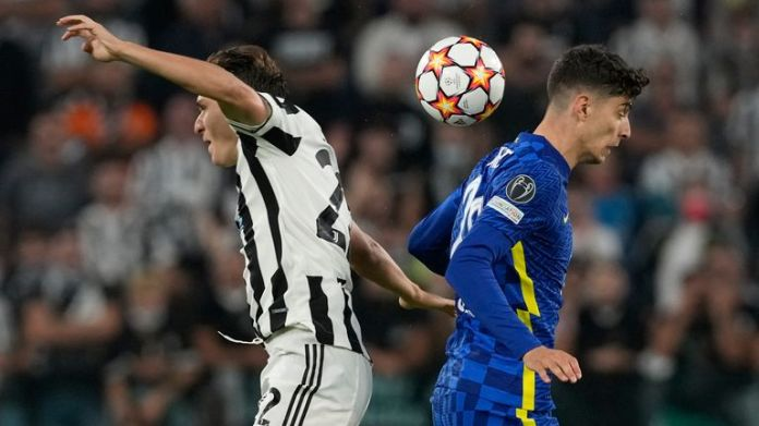 Juventus' Federico Chiesa, left, challenges for the ball with Chelsea's Kai Havertz during the Champions League group H soccer match between Juventus and Chelsea at the Allianz stadium in Turin, Italy, Wednesday, Sept. 29, 2021. (AP Photo/Antonio Calanni)