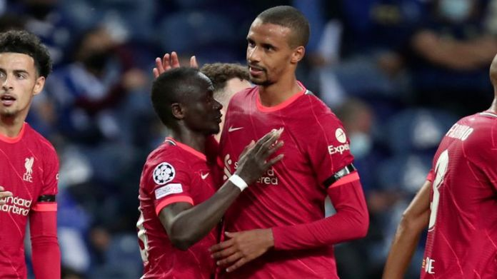 Liverpool's Sadio Mane, 3rd left, celebrates with Joel Matip after scoring his side's second goal during the Champions League group B soccer match between FC Porto and Liverpool at the Dragao stadium