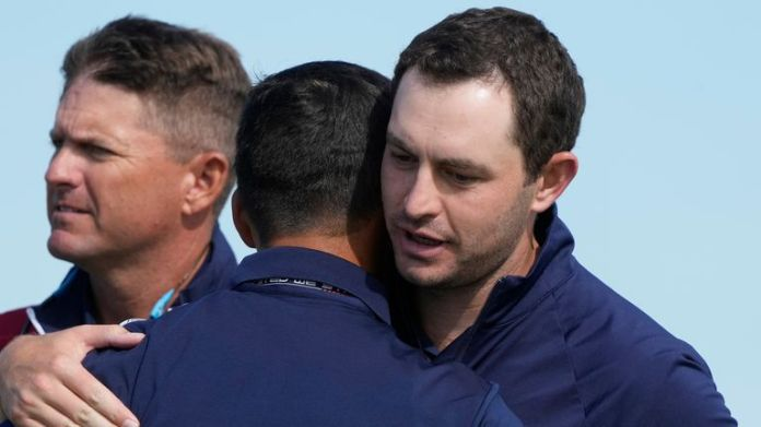 Cantlay and Schauffele celebrate after winning their foursomes match