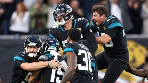 Jacksonville Jaguars players celebrate their first win of the season after Matthew Wright's game-winning kick