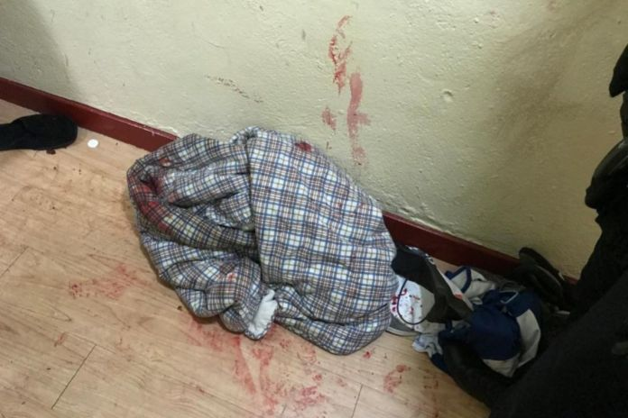 Traces of blood and clothes lying on the ground after an incident in the ...